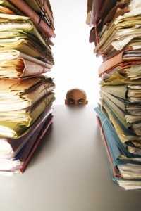Med size man staring at files